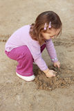 Sand. Baby girl playing in the sand Royalty Free Stock Photography