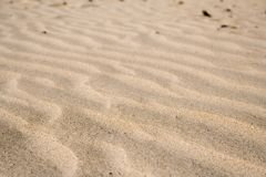Sand. Wave patterns in the sand Royalty Free Stock Photo