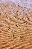 Sand. Yellow sand with ripples Royalty Free Stock Photos