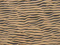 Sand. Horizontal sand stripes on the beach Stock Photos
