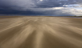 Sand. Beach scene with blowing sand and storm approaching off the sea Stock Image