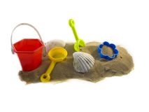 Sand. Toys and shells on the beach isolated Royalty Free Stock Images