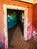 Sand in abandoned house in Kolmanskop ghost town Royalty Free Stock Images