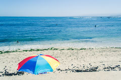 Sand ad sea. View of a beach with a colorfull  umbrella Royalty Free Stock Photo