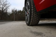 Free Sand Adhered To The Surface Of A Vehicle Tyre On The Road Royalty Free Stock Photography - 113793947
