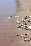 Sand And Pebbles By The Sea Stock Photography