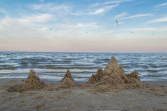 Sand architecture. By the sea, with seagulls circling in the sky Stock Photo