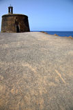 Sand arrecife lanzarote castillo de las coloradas spain the old Stock Image