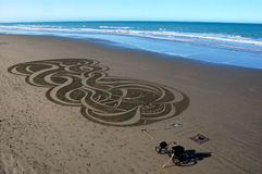 Sand art on Christchurch beach Royalty Free Stock Images