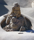 Sand art. A man playing cards made of sand Royalty Free Stock Photo