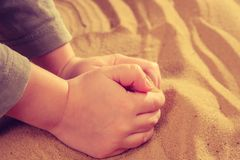 Sand therapy, child`s hands are painted on table with sand. Sand art therapy, child`s hands are painted on a table with sand royalty free stock photos