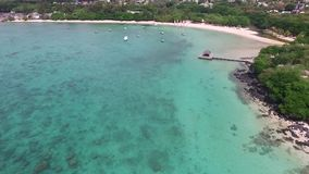 Sand Bach in Mauritius. Flying with drone over the Indian Ocean and people