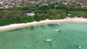 Sand Bach in Mauritius. Flying with drone over the Indian Ocean and people. Luxury yacht and boats on coastline.  stock video