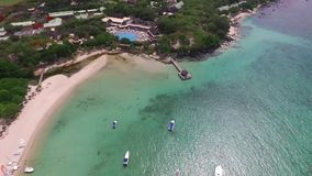 Sand Bach in Mauritius. Flying with drone over the Indian Ocean and people. Luxury yacht and boats on coastline. Albion stock footage