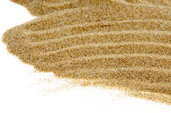 Sand background. Closeup of sand isolated on a white background stock photography