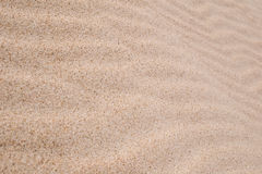 Sand background. Texture of the sand with diminishing perspective Stock Photos