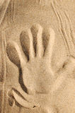 Sand background #3. Hand on sand stock photo