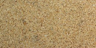 Sand background. Close up view on sand texture Stock Photos