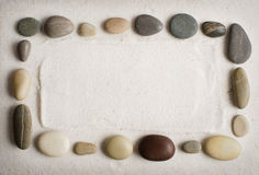 Sand background for inscriptions with pebbles Stock Image