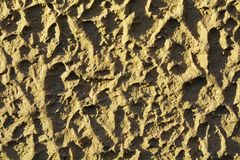 Sand, background. Interesting traces in the sand, made by people and animals, suggesting movement and dynamism, background Royalty Free Stock Photos