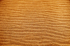 Sand background with a natural wavy pattern Stock Photos