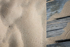 Sand background. Old planks in the sand Stock Photo