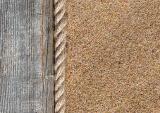 Sand background with old wood and rope Royalty Free Stock Photography