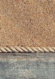 Sand background with old wood and rope Stock Photography