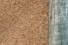 Sand background with old wood Stock Photo
