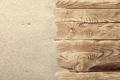 Sand Background. Sand on planked wood. Summer background with copy space. Top view Stock Photos