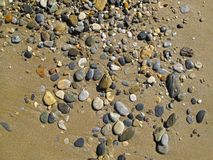 Sand background with sea pebbles stock image