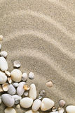 Sand Background. With shells and stones. Sandy beach texture for summer with copy space. Macro shot Stock Image