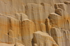 Sand - background and texture. Sandy slope where you can see layers of sediment Royalty Free Stock Photo