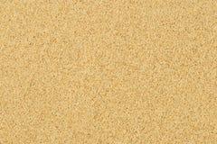 Sand background texture. Yellow sea sand on the beach Stock Photos