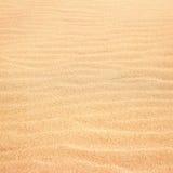Sand background. Wavy sand background, selective focus Stock Photo