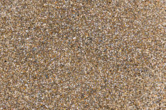 Sand. Background on which wet brown sand royalty free stock photo