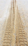 Sand backgrounds and texture, Wheel tracks in the sand backgroun Royalty Free Stock Photography
