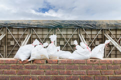 Sand bag and barrier Stock Image