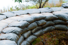 Sand bag bunker with green background Royalty Free Stock Photography