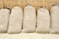 Sand bags. On the beach to prevent water flood Royalty Free Stock Image