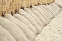 Sand bags on the beach Royalty Free Stock Images
