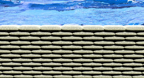Sand bags flood. Wall of sand bags holding back flood waters royalty free stock photos