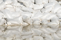 Sand bags and flood water Stock Photos