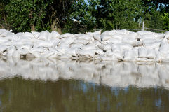 Sand bags and flood water Royalty Free Stock Photo