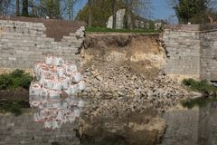 Sand bags preventing new collisions of a city wall royalty free stock image