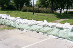 Sand bags protecting rail from flood Stock Images