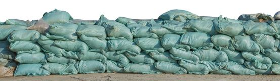 Sand bags stacked isolated on white background, clipping path.  royalty free stock photo