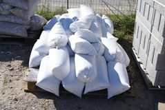 Sand bags, stone chips and bricks for construction Stock Image
