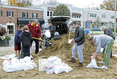 Sand Bags To Fight Flooding. Residents  fill  sandbags with sand to get ready for flood waters from coming storm Stock Image