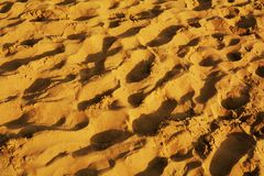 Sand bakground. Sand and small steps on the beach, background and texture Stock Photo